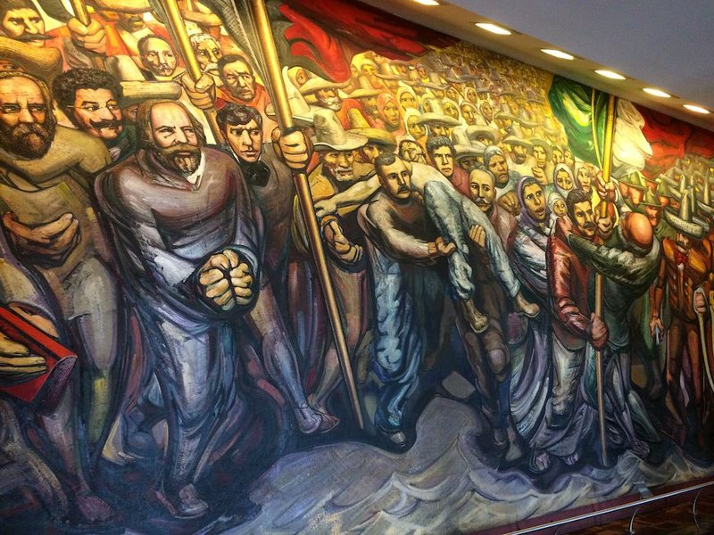 The Cananea Strike in Siquieros' Mural: A man holds in his arms a dead companion. The repression of the strike by the Mexican troops resulted in eleven Mexicans and two Americans dead, several injured, and many run away in fear of a violent repression.