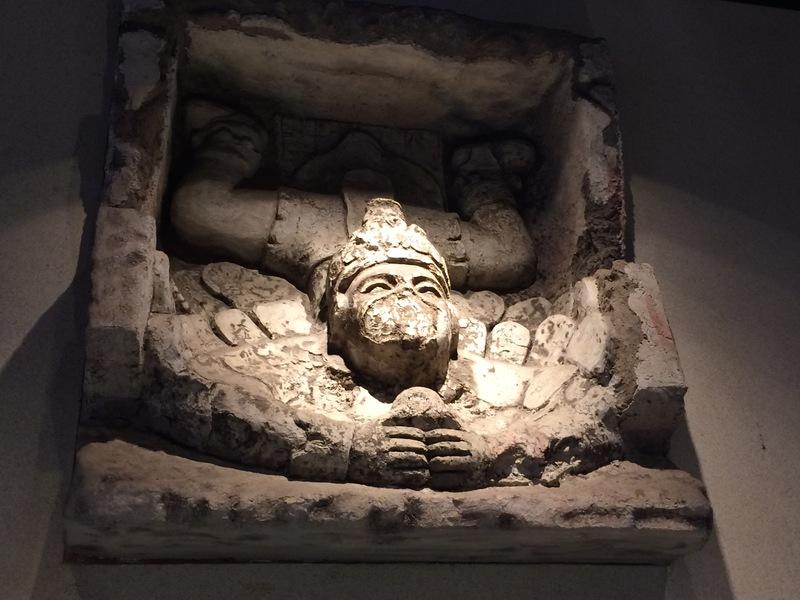 The Descending God Carving