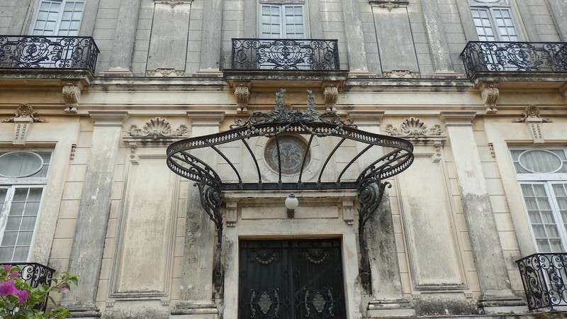 Wrought iron canopy - Front door of the Southern house. The Northern house misses this typically French decorative element.